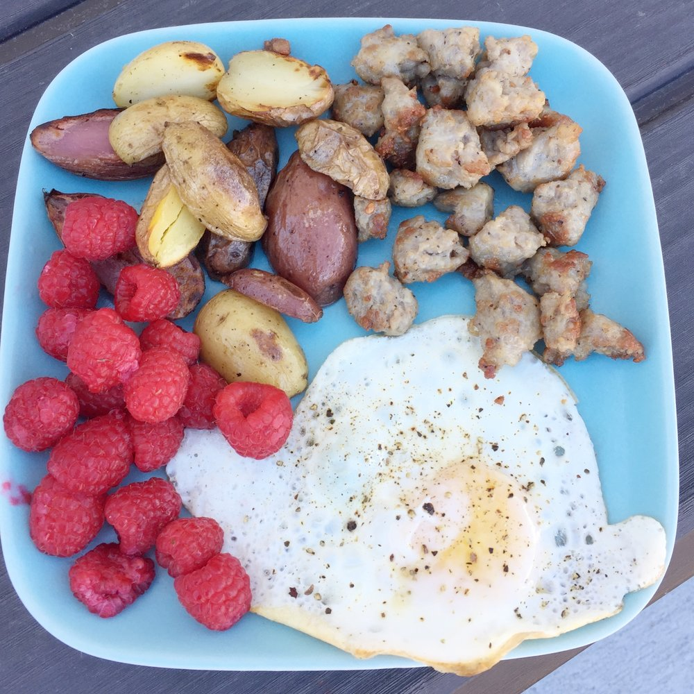 Potatoes, sausages, raspberries and egg.