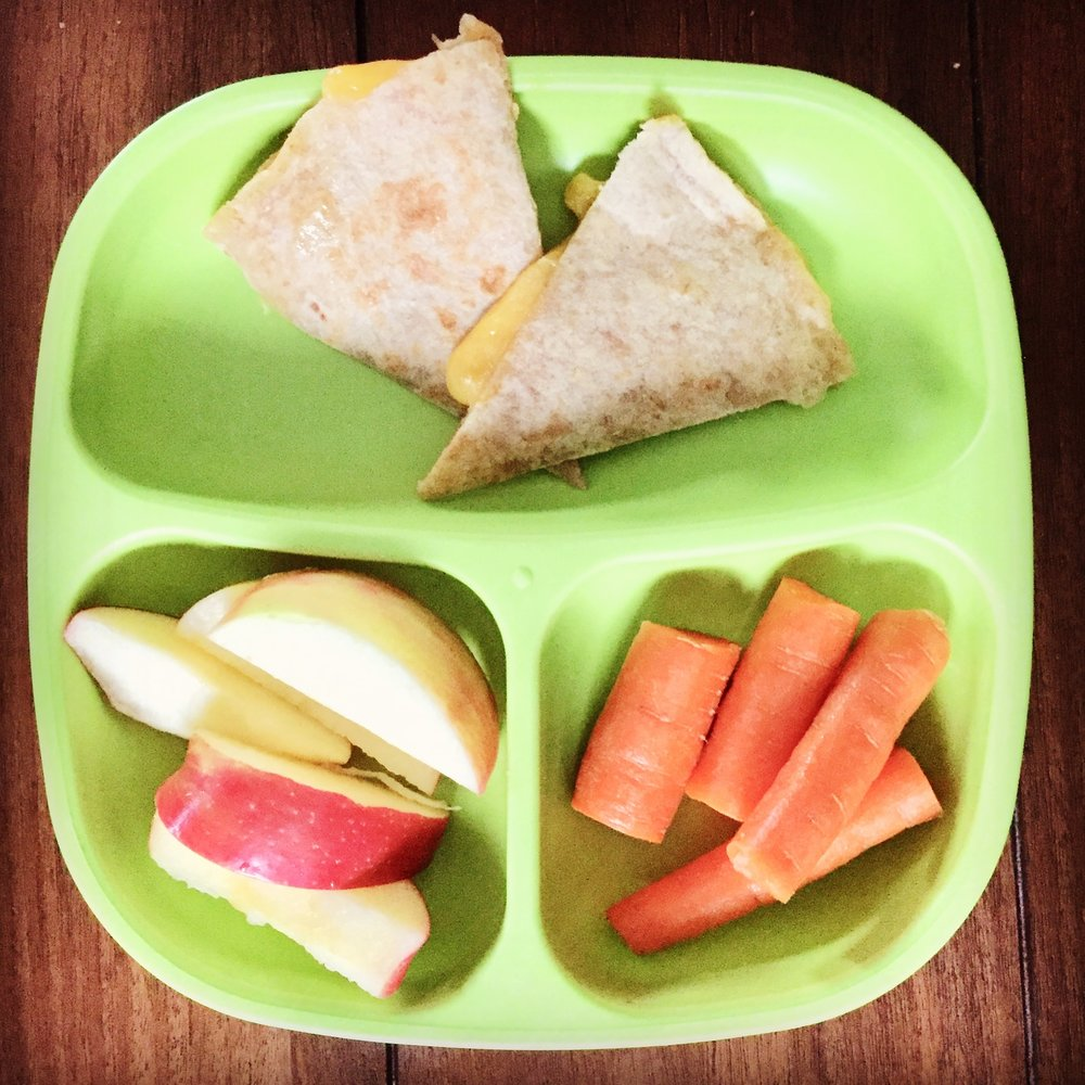 Whole wheat tortillas with cheese, apples and carrots.