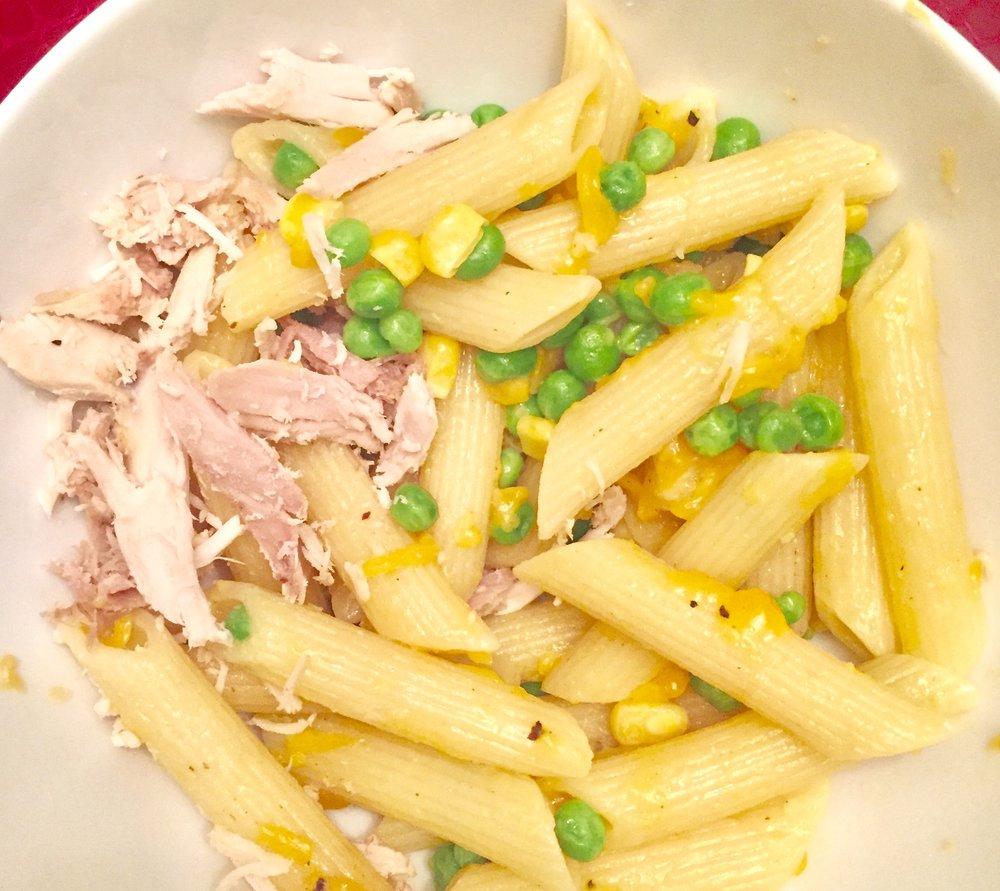 Whole wheat pasta, corn, peas, chedar cheese and chicken.