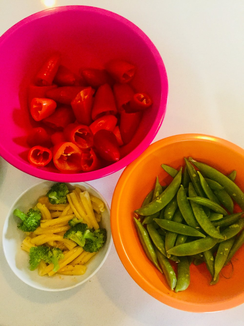 Peppers, snap peas, whole wheat pasta and cooked broccoli (with butter and salt).