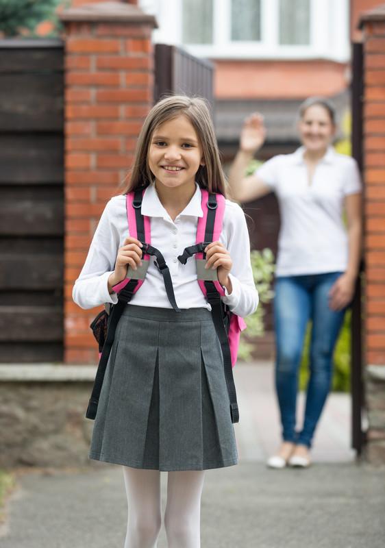 Mum waving child off to school