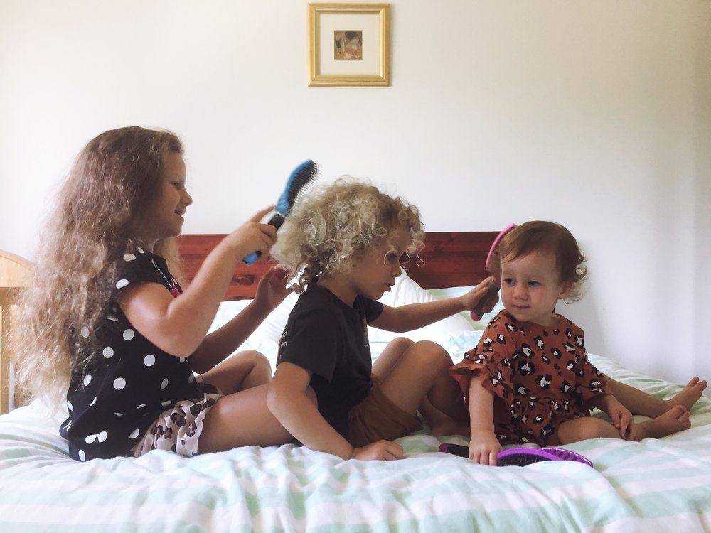 kids brushing hair