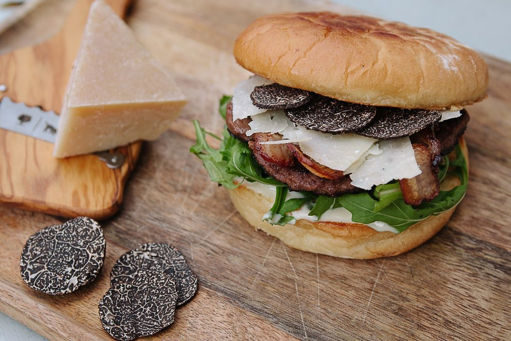 Tall Timbers Deluxe Truffle Beef Burger w/ Smoked Bacon, Aged Cambray Cheddar, Beetroot Mayonnaise, Rocket & Shaved Fresh Truffle & Wine Co Black Truffle (10 grams)$39.00 - Availability: Lunch & Dinner