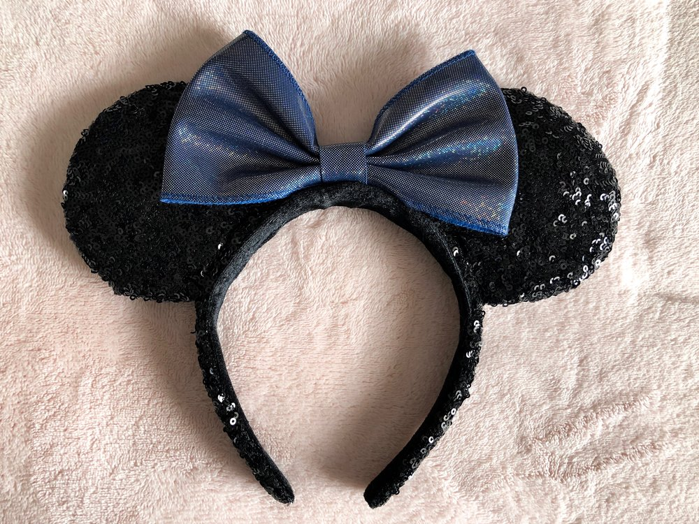 Minnie Ears - Of course, I have to bring along my ears!! Where would I be without these bad boys? I have a whole collection of ears that I alternate between, but you can almost always guarantee that there's a pair in my bag or on my head!