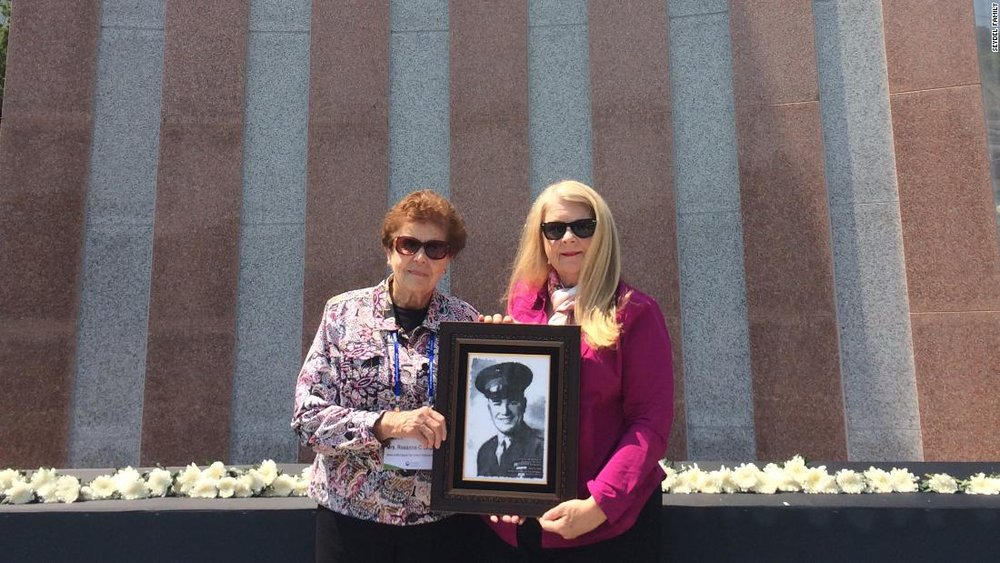 Rosanne Seydel and Ruth Hebert hold the portrait of First Lieutenant Karle Seydel, who was killed on December 7, 1950 during the Korean War // Seydel family