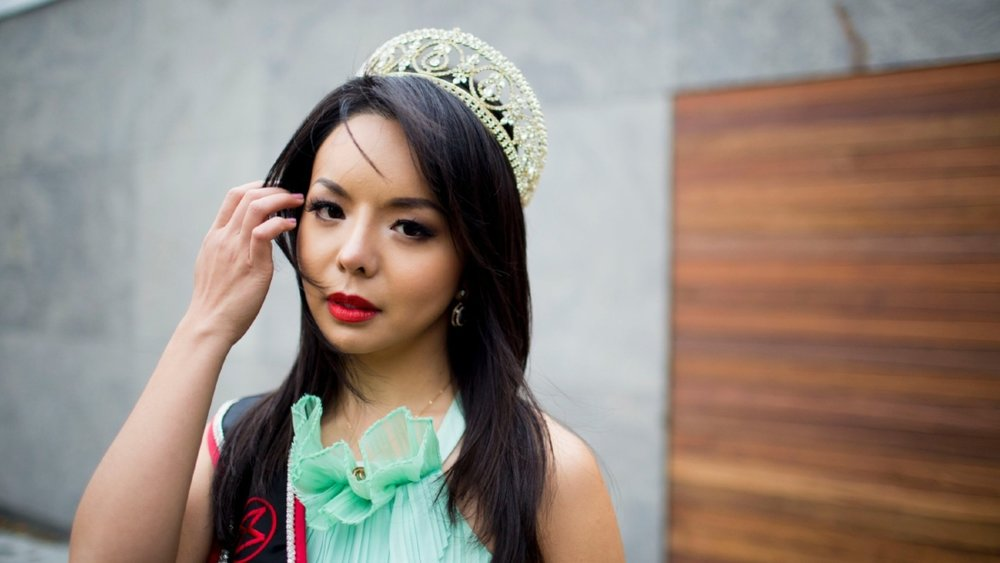 Banned in China and censored in US, beauty queen not backing down -
