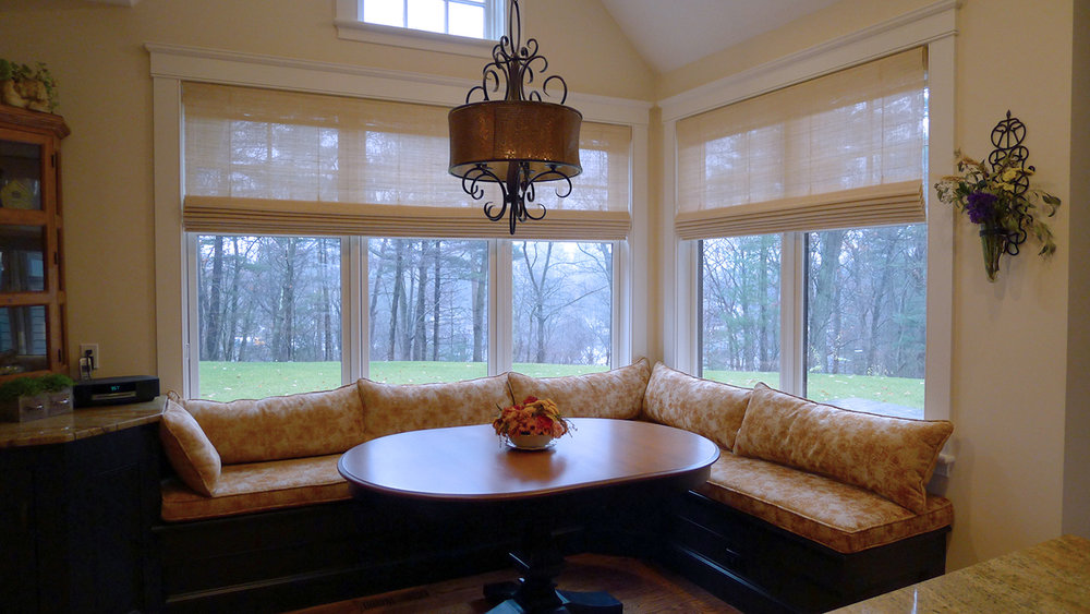 Natural woven wood shades add privacy and texture.