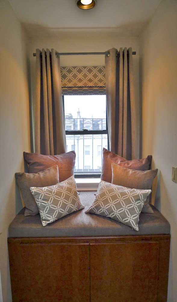 Window seat solutions - Grommet draperies and a custom-sized cushion with pillows turn a forgotten space into a comfortable seating area.