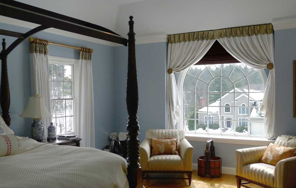 Contrast banded draperies - By combining two complementary fabrics this master bedroom becomes a one-of-a-kind design.