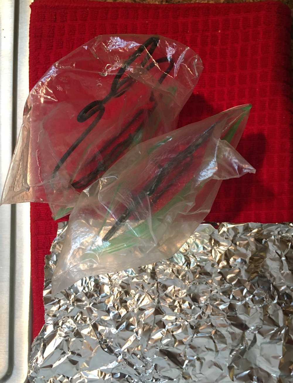 Cleaned plastic bags and aluminum foil for reuse