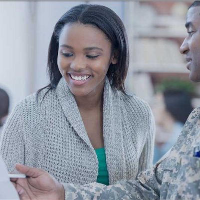 woman signing up for military service with veteran