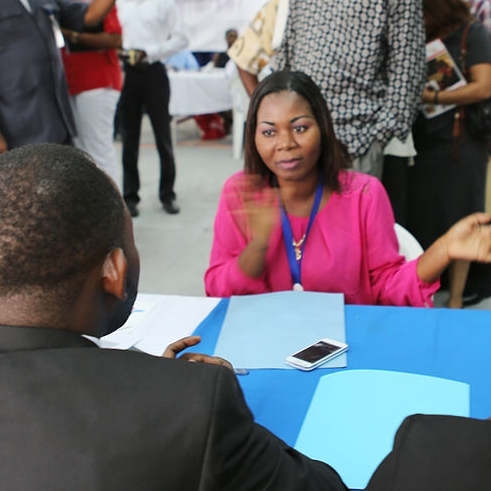 man and woman talking at job fair