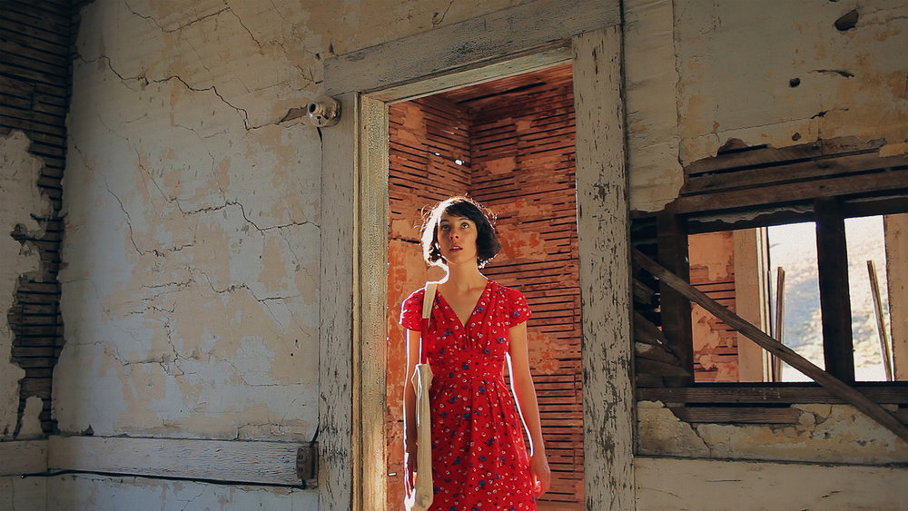 Alice (Zoey Taylor) explores an abandoned old homestead. The Magic Hours - a film by Zoey Taylor and David Connelly