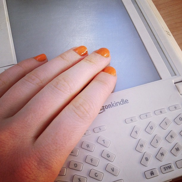 "vneckandacardigan :     Orange nails and a ridiculous looking first generation Kindle (Taken with  instagram )     It's not that I don't appreciate technology. I'm typing on a beautiful white machine that's not connected to any wires but is connected to the internet and is light enough to rest on my stomach. And I like reading about Alexis has recently eaten, which technology allows me to do. (And I like Alexis, who I even met once.)   It's just that, how much technology do we need? Because at a certain point (maybe now?) they're just inventing stuff so we'll buy more stuff again. For the past 400 years, no one looked at a book, and thought, damn, that shit looks antiquated. But after four years, a first generation Kindle looks ""ridiculous.""    My often wise dad once said, ""We live better than Louis XIV."" Which is true when you think about indoor planning and access to tropical fruit. But it seems like all we're striving for now is convenience and novelty. But something nice about inconvenient, old things: they're not part of this absurd cycle of want that technology creates now."