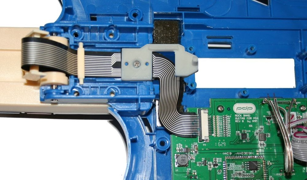 Bracket piece and ribbon cable back in place