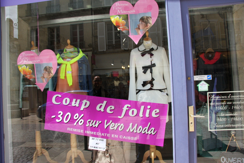 Cute clothes in a shop window in Avallon, France