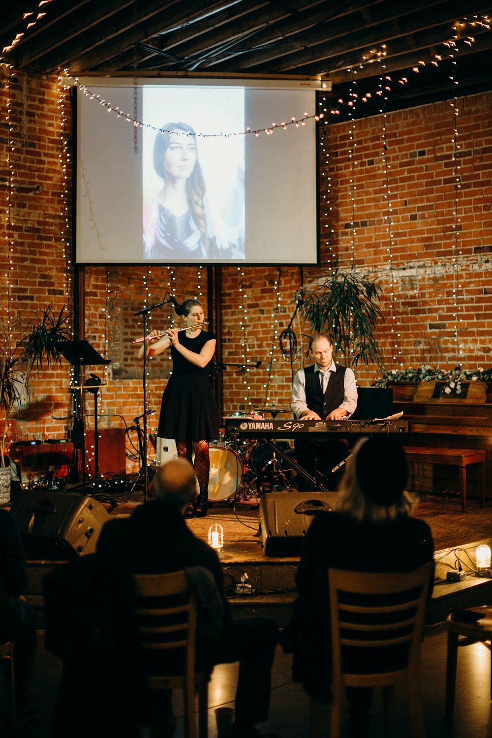 inspire duo performs for an art opening at the bolt Gallery in Fort collins, colorado photo courtesy of  Crista tppmann photography