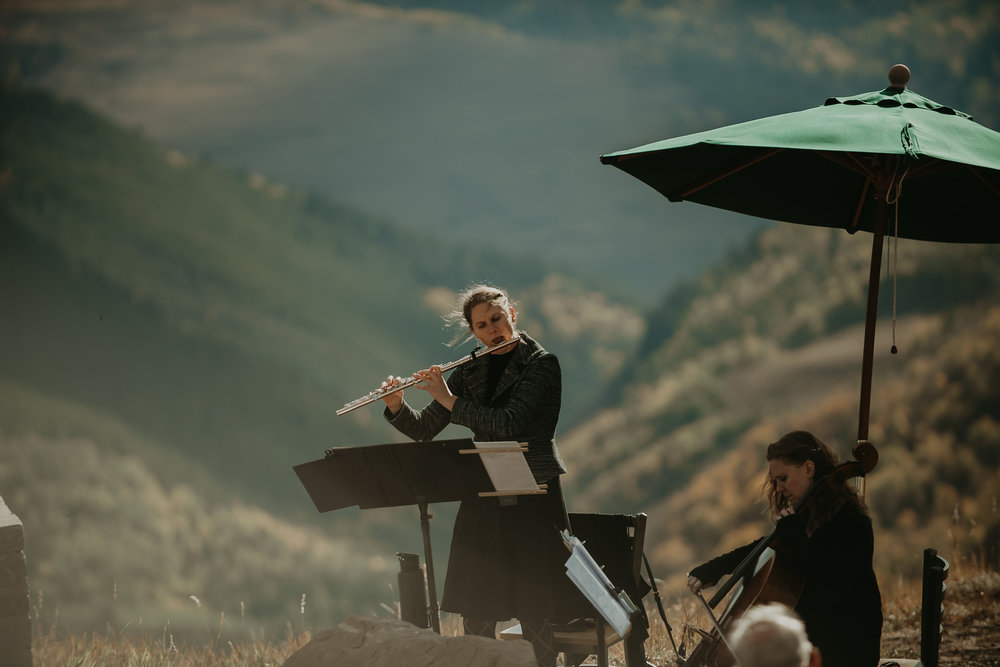 Flute and cello rap and popular wedding ceremony music at the holy cross event deck in vail, colorado, Photo by back country imagery