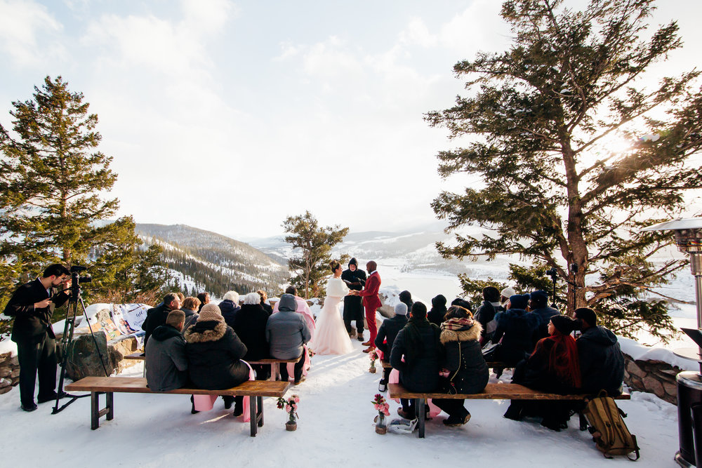 Classical and contemporary solo flute wedding ceremony music at Sapphire Point in Dillon, Colorado, photo by Mallory Munson Photography