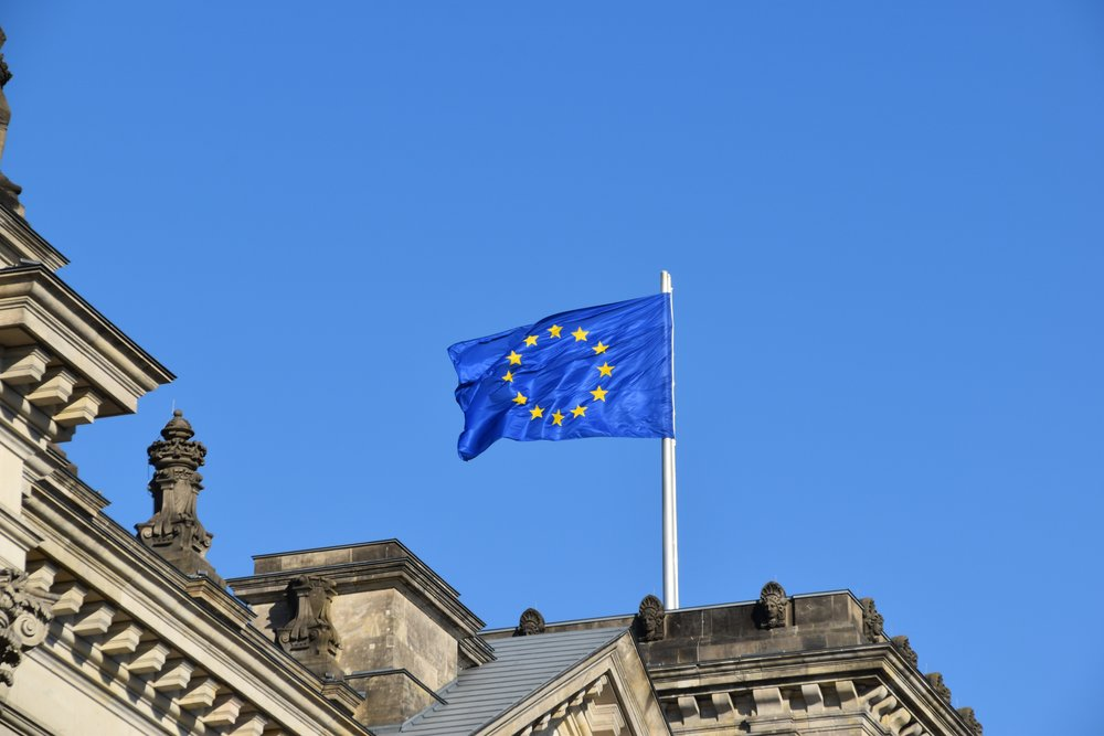 The European flag above a building in Berlin, Germany. Photo credit Waldemar Brandt (Unsplash)