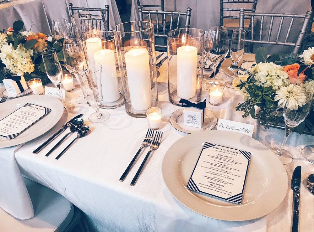 A beautiful table scape at a Charleston wedding with my hand lettered place cards