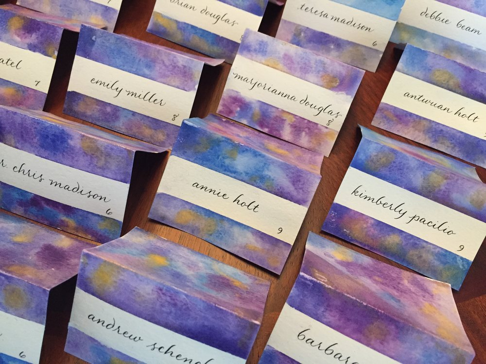 Hand-painted water color escort cards for an elegant event at The Mint Museum
