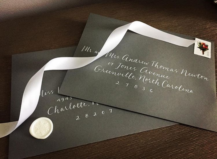 White ink on charcoal envelopes for a winter wedding