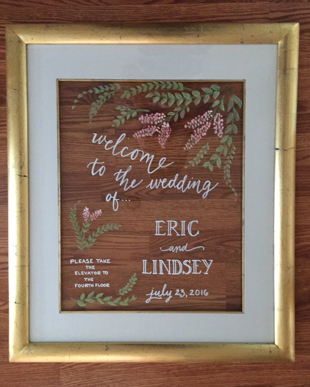 Wedding welcome signage on glass