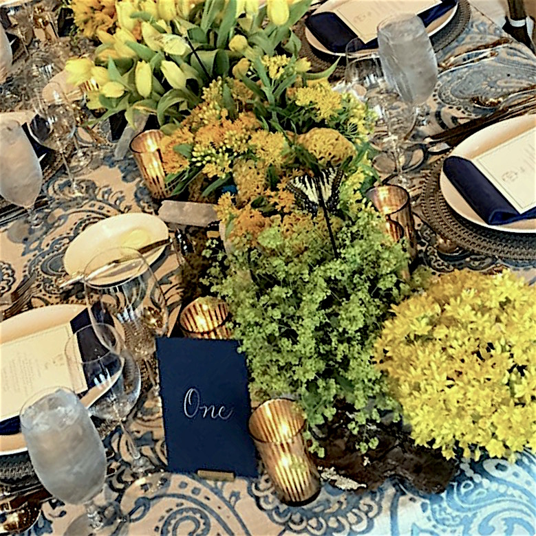 Navy table cards with numbers written