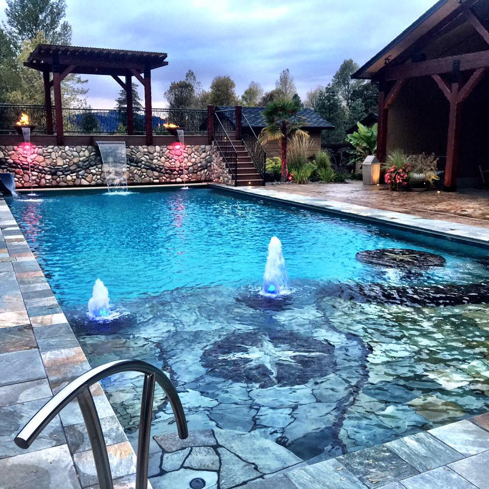 Custom Functional Art - To a certain degree, every project undertaken is custom. No two pools from David Owens are the same. Then there are the extras, like the Pergola with water and fire features that sit atop a rock wall, overlooking the pool. Whether it's a customized sun shelf  or a complete remodel of the backyard landscape, Owens Custom Pools can turn the wow factor up to 11.
