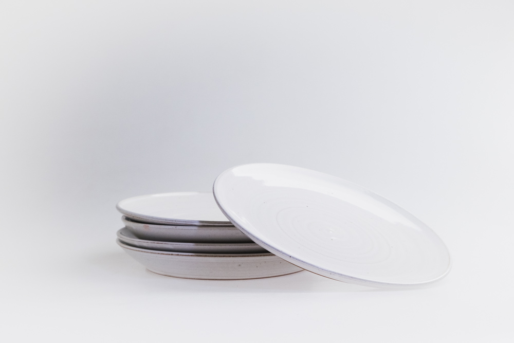 White gloss dinner plates produced for Woodstock Coterie Restaurant in early 2018 as part of a complete dinner setting.