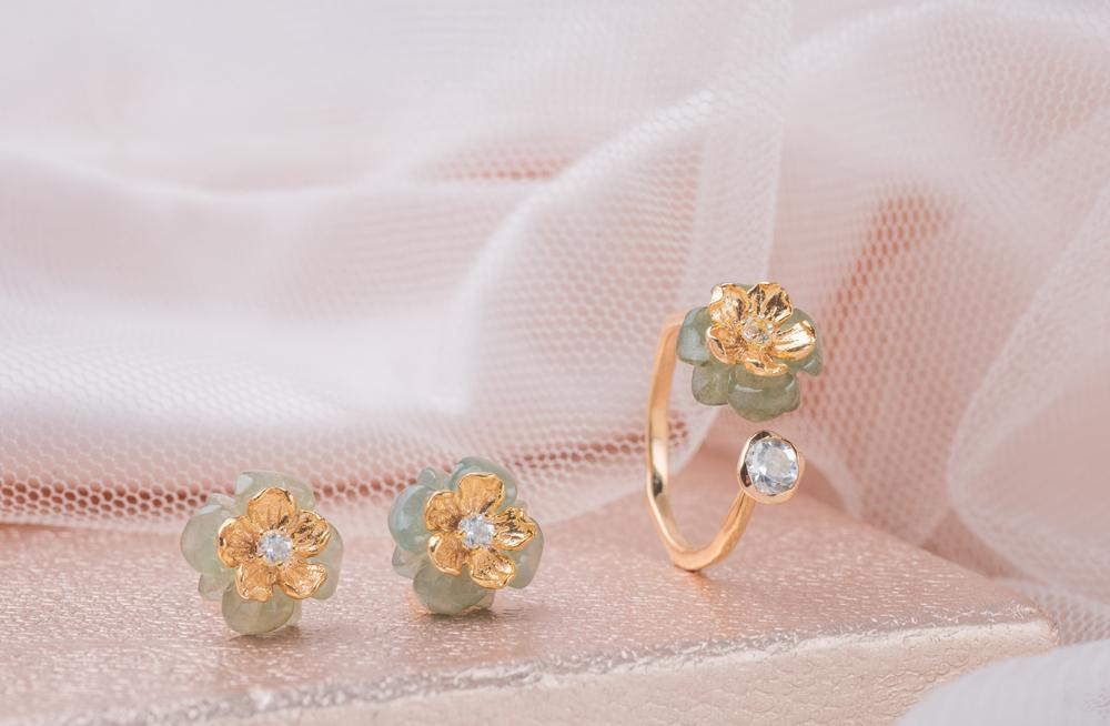 The Becoming Collection - The Becoming Collection is inspired by, and made for the believers, the adventurers, and the dreamers. Plated in the dreamiest champagne gold and paired with brilliantly custom-cut jade to mimic soft petals, the Adventurer's Earrings and Dreamer's Open-Ended Ring were designed to represent inner strength, and tenderness of heart.