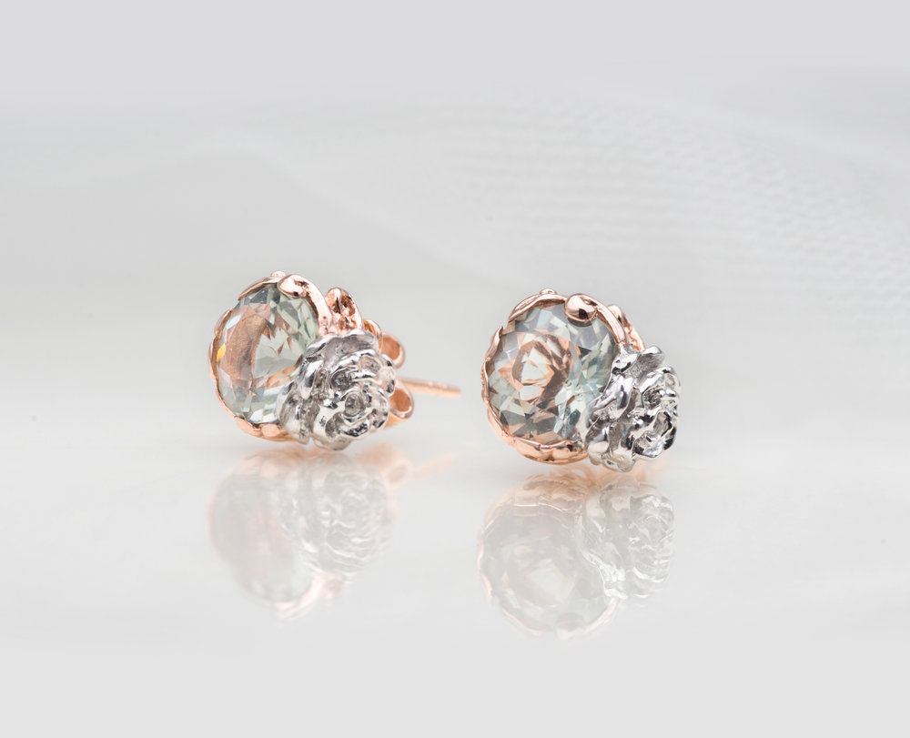For Your Wife - the love of your lifeFlowers are romantic gestures, and the Flower Jade Studs in 9KT solid gold takes it to a whole new level. This pair of studs features a main gemstone of your choice with a lovely Camellia flower motif at the side – a symbol of devotion among lovers. It is said that the Camellia flower's petals reflect the virtues of a lady. Top that off with a selection of coloured and symbolic gemstones ranging from moonstones to amethysts, the Flower Jade Studs say 'I Love You' like never before.