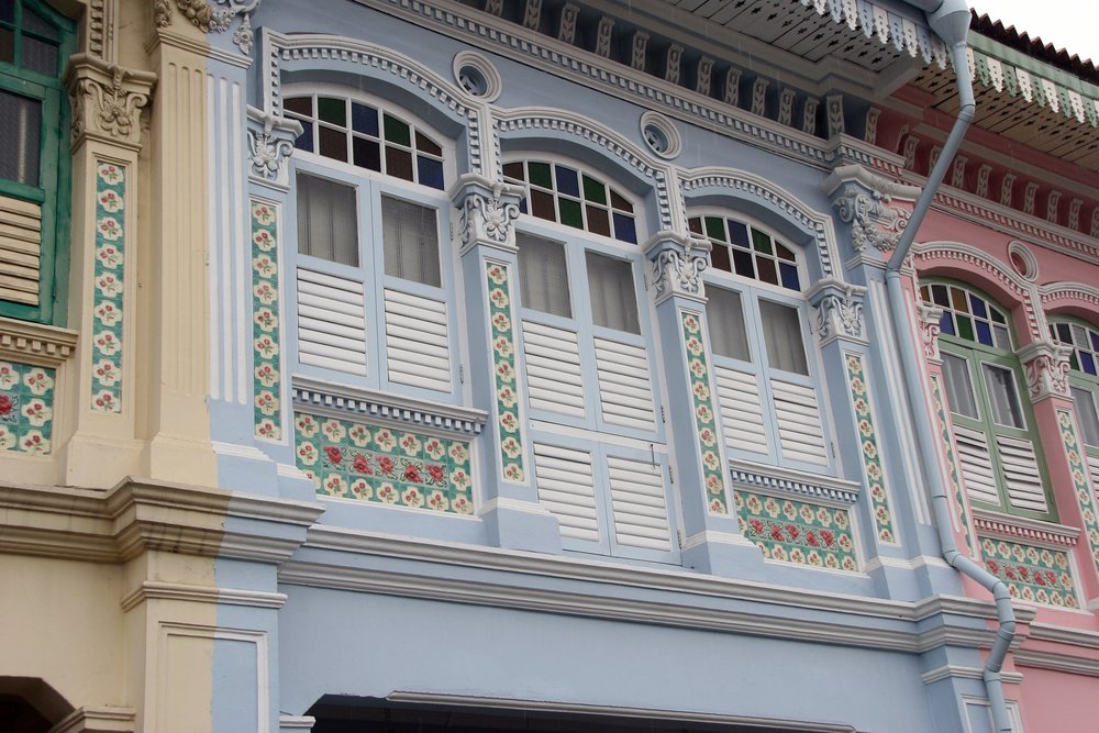 Peranakan tiles framing the windows of a shophouse in Koon Seng Rd, Singapore. Photo credits to Flickr.