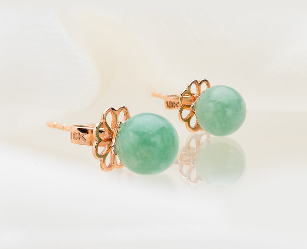 -  The Aura Jade Studs in 18kt Rose GoldLush emerald green Jadeite beads take centrepiece in the Aura Jade Studs, and are exclusively detailed with Choo Yilin floral backings, making this 18kt piece a stunning classic. Exclusively launched for Mother's Day.