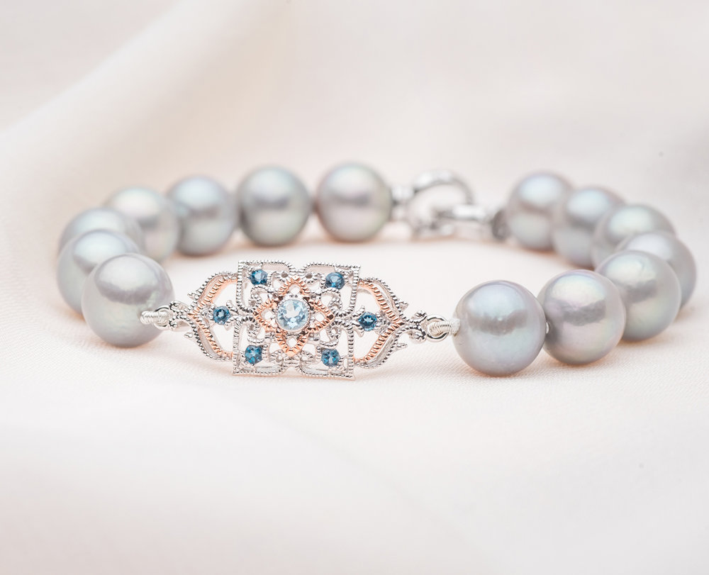 - The peranakan lace pearl bracelet (9kt special edition)Luxurious and radiant, the grey pearls add a touch of light to wreathe its wearer with an enchanting glow. Each bracelet is hand-strung, and come in limited quantity in our Flagship Boutique as well as online.