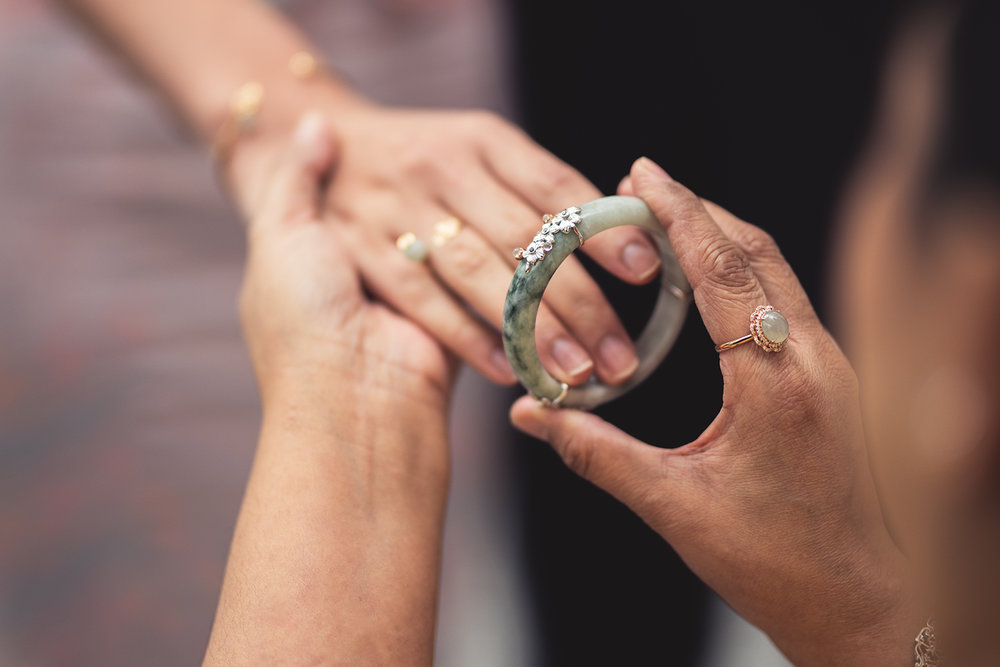 The bride receives a Sakura Jade Bangle, a precious keepsake of this momentous occasion.