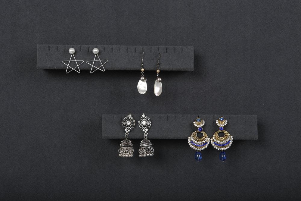 Magnetic earring holder -