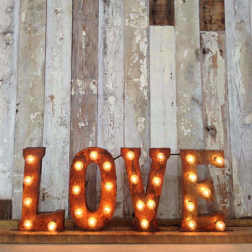 Love sign on wood wall.JPG