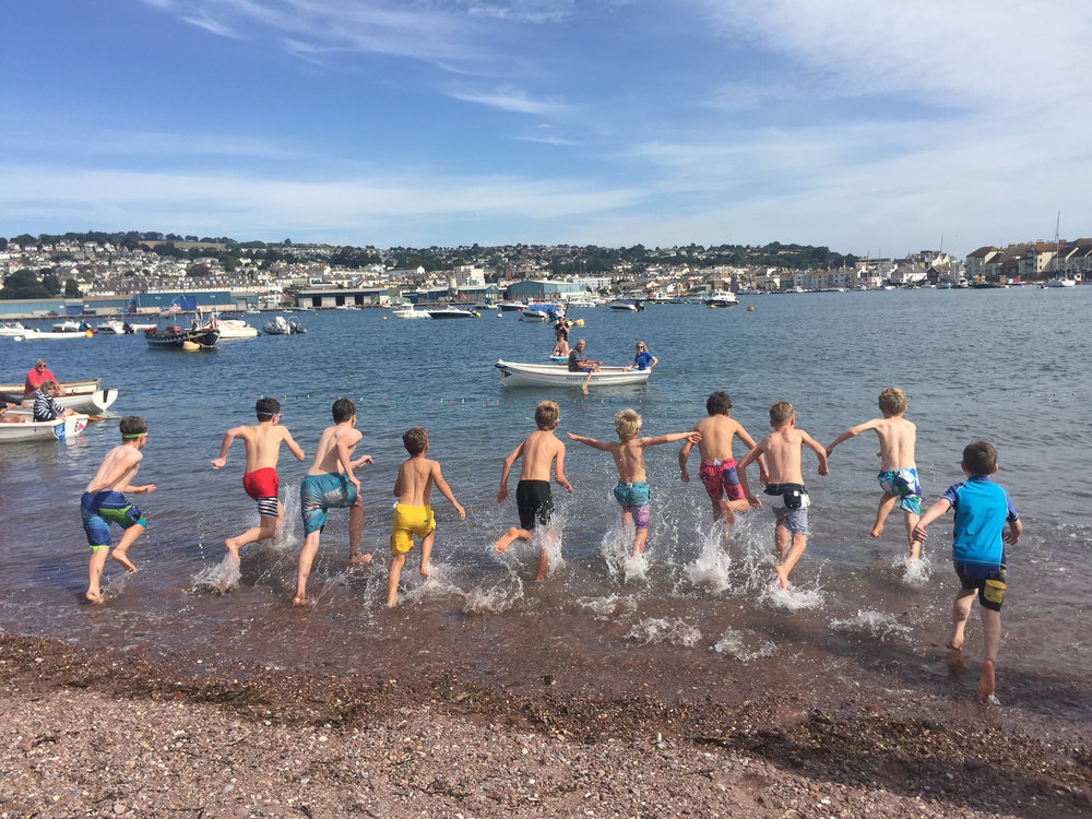 Happy-go-lucky water sports - These are swimming races in the sea of different distances and age categories. The start of the race is standing on the beach, you swim out to a line held between two boats, grab a clothes peg and race back to the shore!