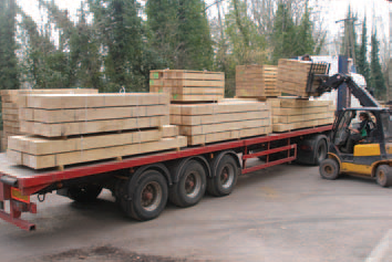 Beams being loaded for Jonny Briggs to use at Dumfries House