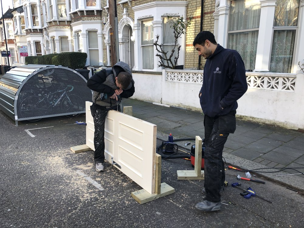 Here are James and Atila adding smoke seals to the doors at Kenwyn Road to comply with the Council's licensing requirements