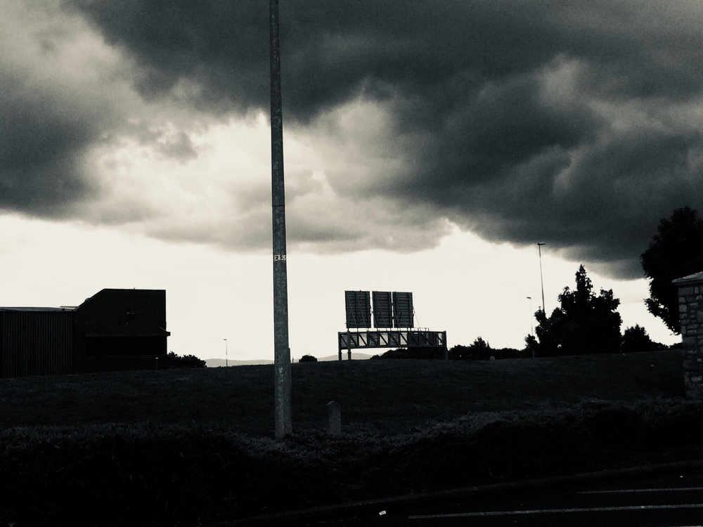 black and white image of dark clouds in the sky