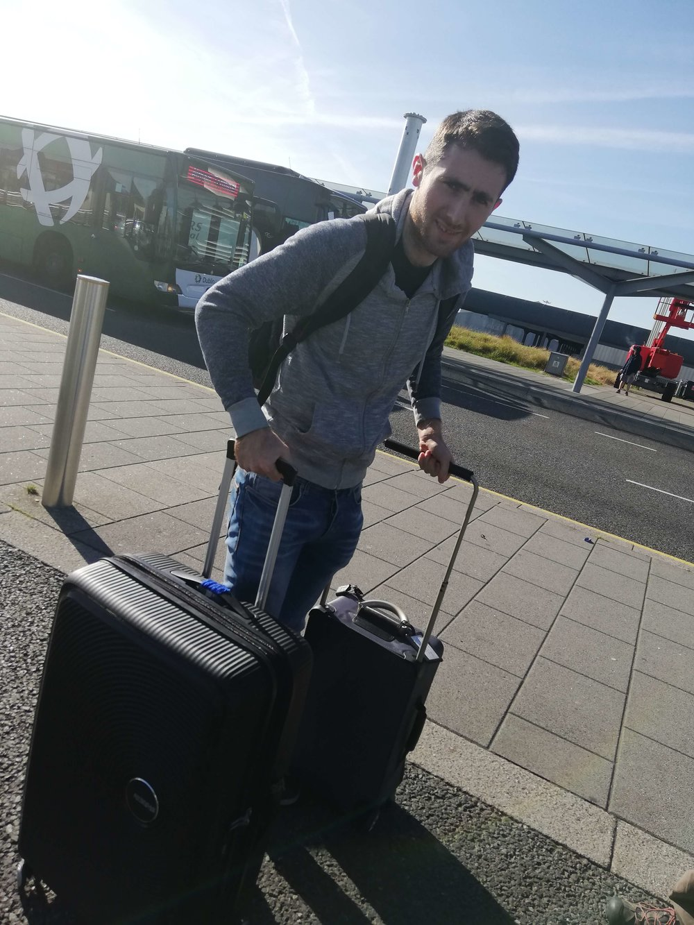 Man with two suitcases at the airport