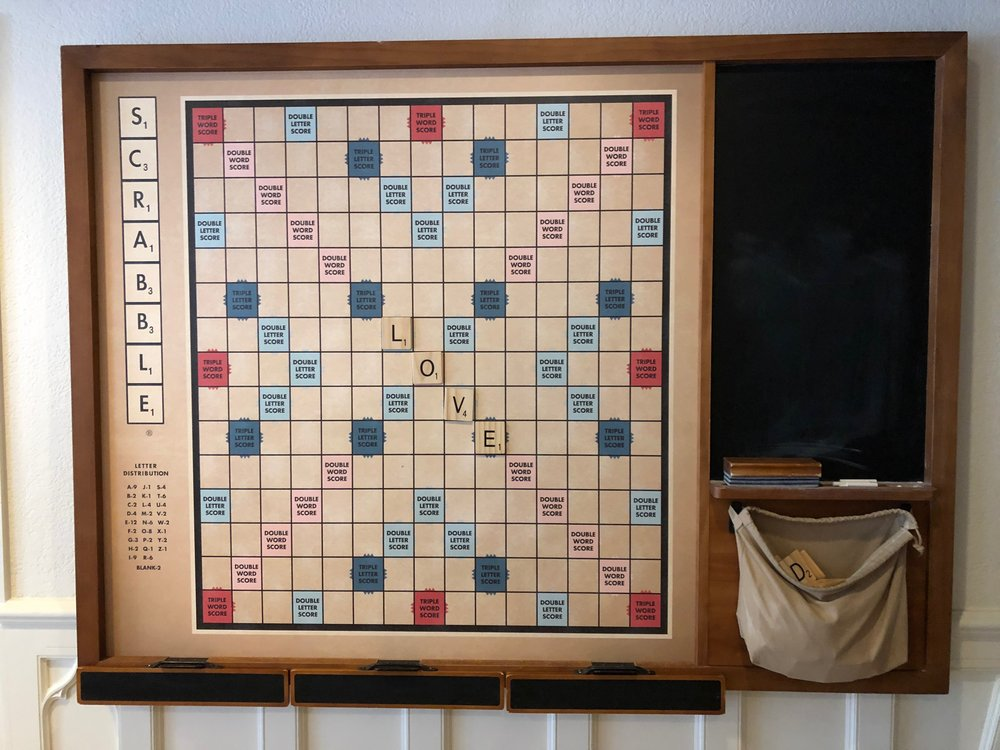 Johnny Boy leaving his mark on the hotel scrabble board