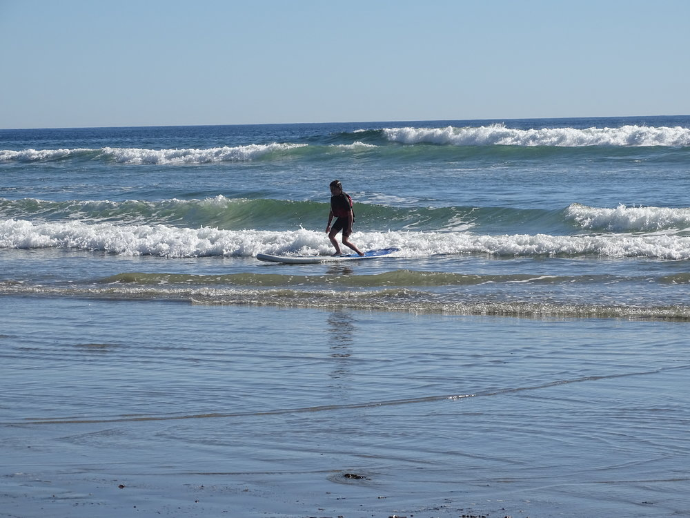 Isla riding a wave in