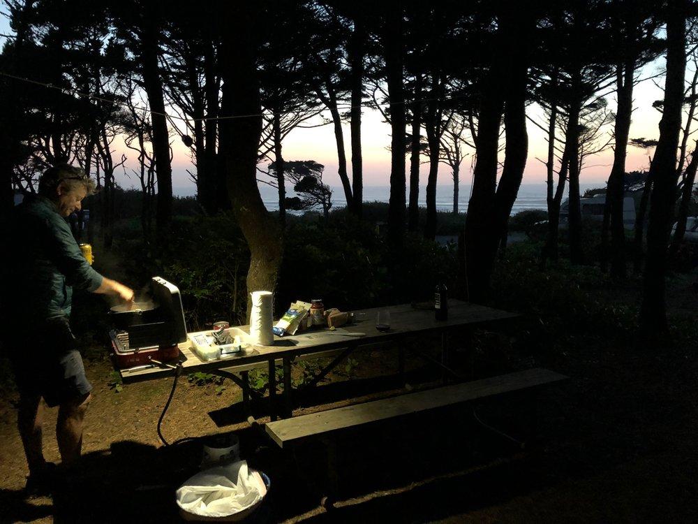 John cooking dinner at camp