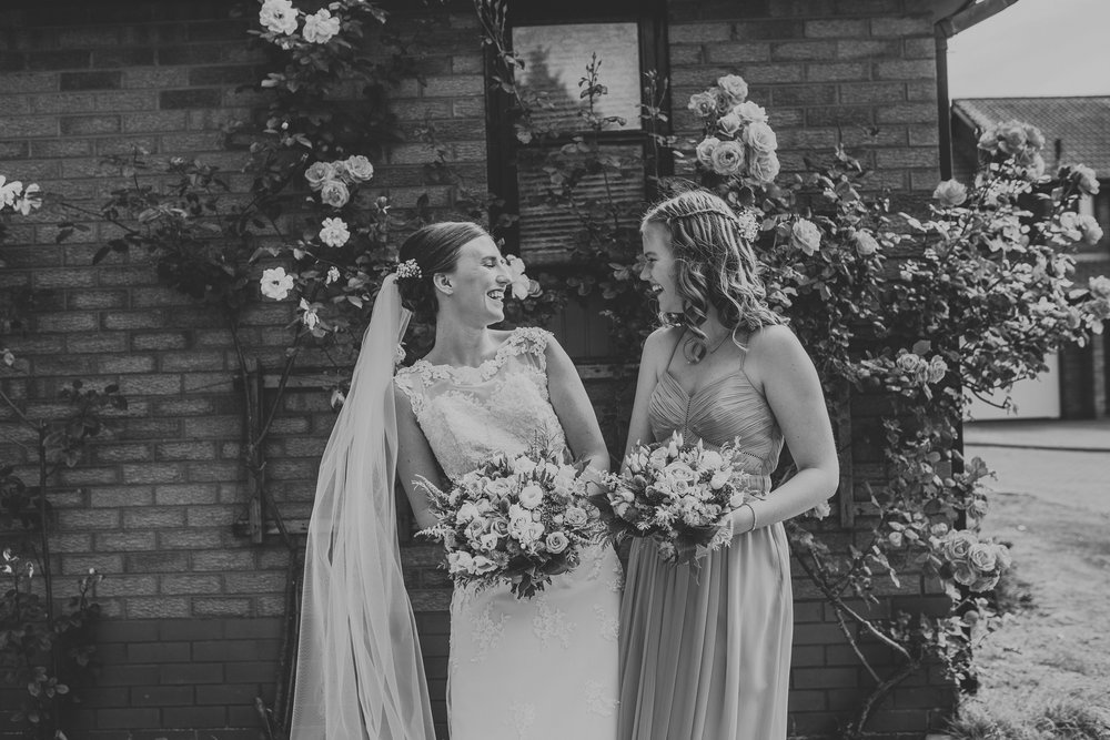 Jess and Ben - Liverpool wedding - two sisters laughing
