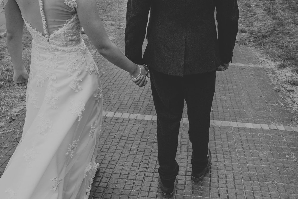 Jess and Ben - Liverpool wedding - black and white, bride and groom holding hands