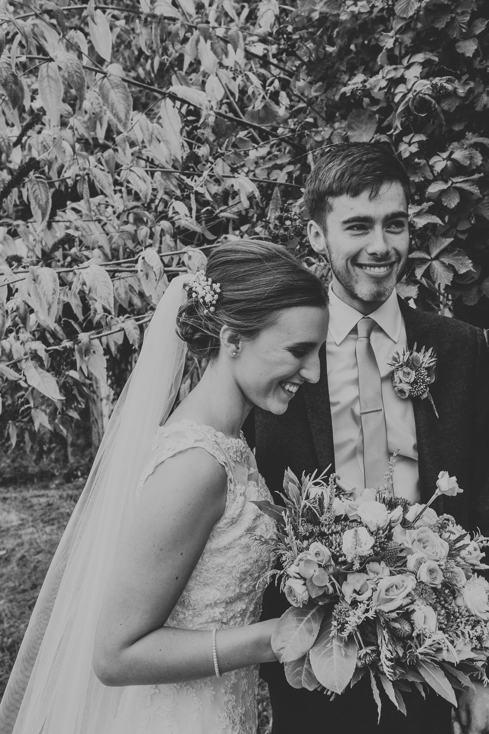 Jess and Ben - Liverpool wedding - black and white bride and groom smiling